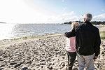 Senior adult couple enjoying beach