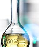 Laboratory beaker containing chemical formula