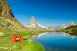 Tent on the shore of lake Riffelsee facing the Matterhorn, Zermatt, canton of Valais, Swiss Alps, Switzerland, Europe