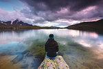 Girl by the Manzina lake at sunset, Valfurva, Valtellina, Lombardy, Italy, Europe