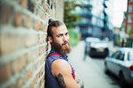 Confident male hipster on urban sidewalk
