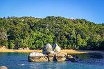 Round stone boulder and sand bay in Abel Tasman National Park. New Zealand