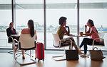 Businesswomen talking in airport business lounge