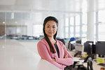 Portrait confident, ambitious businesswoman in office