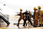 Firemen training, firemen spraying water at training facility