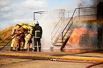 Firemen training, firemen spraying water at training facility stairway