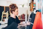 Fashion designer choosing fabric