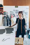 Portrait of fashion designer in her work studio