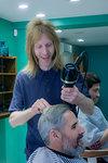 Barber working in barbershop