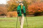 Mature woman nordic walking in park