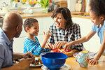 Happy Family around Kitchen Table
