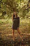 Woman Standing Barefoot in Garden