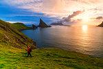 Trekker on the hiking trail to Drangarnir rock, Vagar island, Faroe Islands, Denmark, Europe