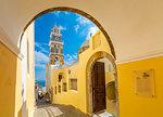 View of clock tower of Church Ag Loannis Baptistis, Fira, Santorini (Thira), Cyclades, Greek Islands, Greece, Europe
