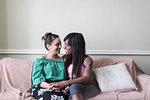 Affectionate lesbian couple on sofa
