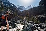 Women hiking in majestic, craggy mountain landscape, Yoho Park, British Columbia, Canada