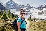 Portrait confident female hiker on sunny, idyllic mountain trail, Yoho Park, British Columbia, Canada