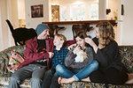 Family relaxing on living room sofa