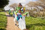 Portrait happy multi-generation women volunteering, cleaning up litter in sunny park