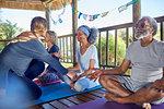 Yoga class meditating in hut during yoga retreat