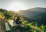 Couple enjoying sunny, idyllic hillside view, Chas de Egua, Portugal