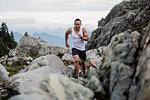 Male hiker running over rocks, Dog Mountain, BC, Canada