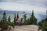 Woman hiking on mountaintop, Dog Mountain, BC, Canada