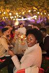 Portrait happy woman drinking wine, enjoying dinner garden party