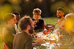 Friends enjoying dinner garden party