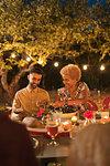 Couple enjoying dinner garden party