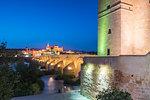 Dusk lights on Puerta del Puente and Calahorra tower (Torre de la Calahorra), gate of Islamic origin, Cordoba, UNESCO World Heritage Site, Andalusia, Spain, Europe