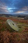 Abandoned millstone below Stanage Edge, Peak District National Park, Derbyshire, England, United Kingdom, Europe