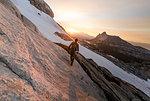 Climber enjoying view on peak, Tuolumne Meadows, Yosemite National Park, California, United States