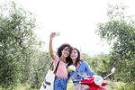 Friends taking selfie in olive grove, Città della Pieve, Umbria, Italy