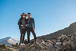 Couple posing on rocky hill, Ölgiy, Bayan-Olgiy, Mongolia