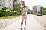 Man using virtual reality goggles in urban Berlin, Germany