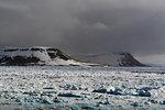 Sea ice coastal landscape and storm clouds, Wahlenberg fjord, Nordaustlandet, Svalbard, Norway.