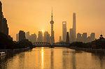 Golden sunset over Waibaidu Bridge and Pudong skyline, Shanghai, China