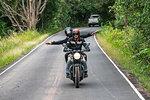 Couple riding motorbike on rural road at Khao Yai National park, Pak Chong, Nakhon Ratchasima, Thailand