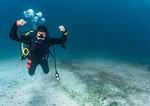 Strong pose of female scuba diver close to  Komodo Island, portrait, Nusa Tenggara Timur, Indonesia