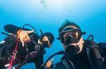 Scuba-diving couple underwater selfie, Komodo Island, portrait, Nusa Tenggara Timur, Indonesia