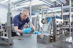 Engineer measuring part in engineering factory
