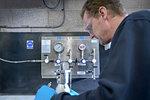 Engineer pressure testing component in engineering factory
