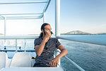 Man drinking coffee on ferry, Corfu, Kerkira, Greece