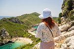 Tourist enjoying view on cliff top, Porto Timoni beach, Corfu, Kerkira, Greece