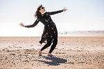 Woman dancing on beach