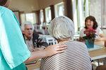 Female nurse taking care of senior people in nursing home