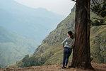 Woman enjoying view on hilltop, Ella, Uva, Sri Lanka