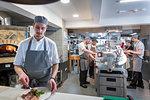 Kitchen staff and chefs in Italian restaurant kitchen