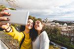 Girlfriends taking selfie in city, Madrid, Spain